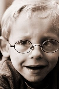 Dribbling kid with round glasses Visual Q Eyecare Melbourne